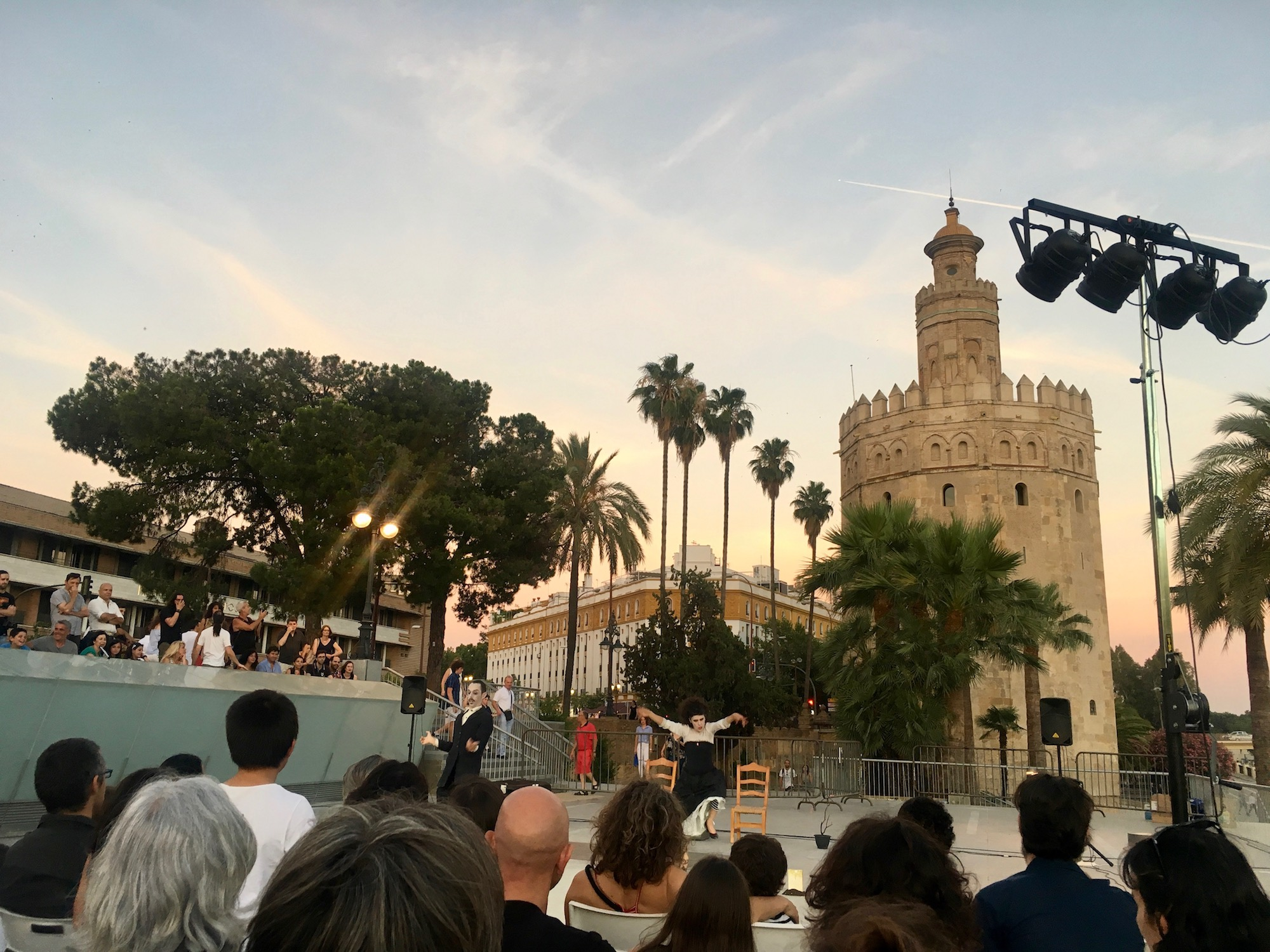 free circus performance in front of Torre del Oro